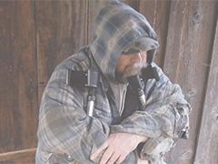 Man missing a leg holding crutches