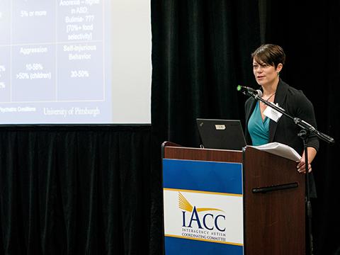 Speaker presenting at IACC Health Workshop
