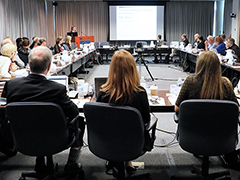IACC Members around table during meeting