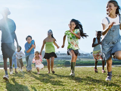 Photo of kids running up a hill